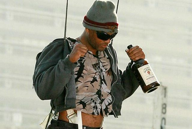 Will Smith drowning his few remaining sorrows after Hancock disproves the naysayers.