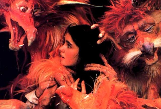 Jennifer Connolly besieged by the fireys in Labyrinth (1986)