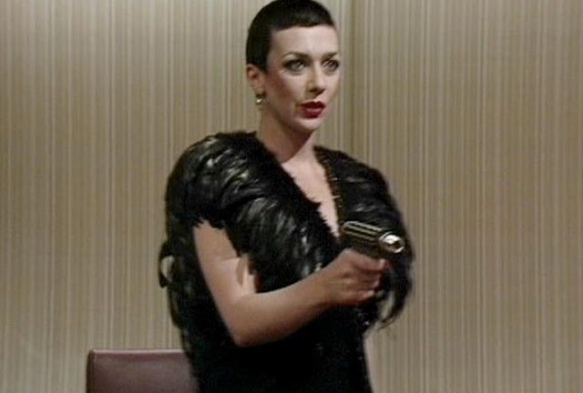 Servalan shooting the man who chose the wallpaper for Animals.