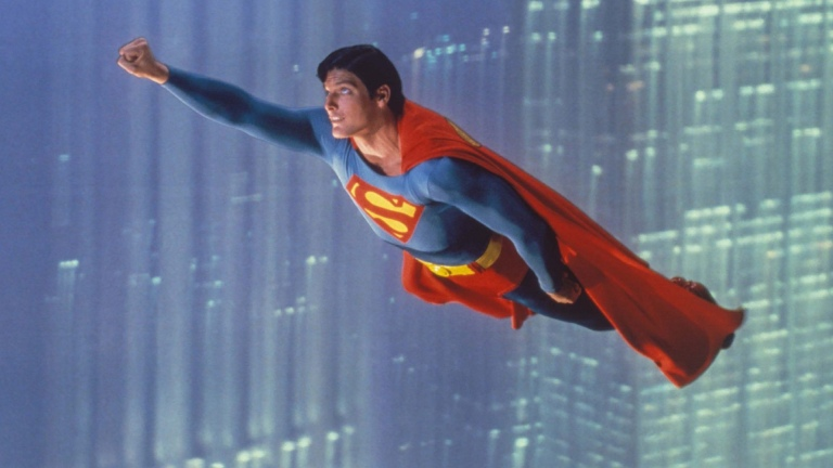 Christopher Reeve's Superman flying through the air;