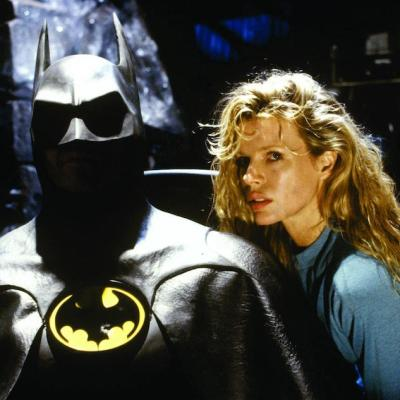 Michael Keaton as Batman and Kim Basinger as Vicki Vale
