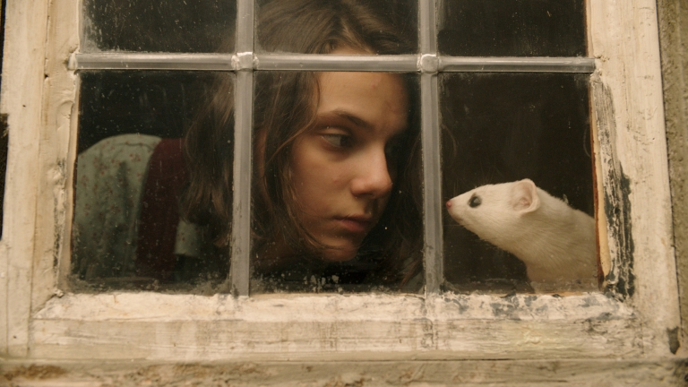 Dafne Keen as Lyra with Daemon Pan in HBO's His Dark Materials TV Show