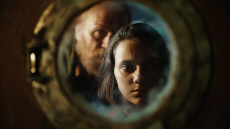 Dafne Keen as Lyra and James Cosmos as Farder Coram in His Dark Materials Episode 3