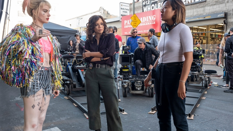 "MARGOT ROBBIE, ROSIE PEREZ and director CATHY YAN on the set of Warner Bros. Pictures' ""BIRDS OF PREY"