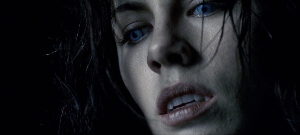 Kate Beckinsale in Underworld with Blue Eyes and Fangs