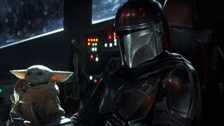 Pedro Pascal and Baby Yoda on The Mandalorian