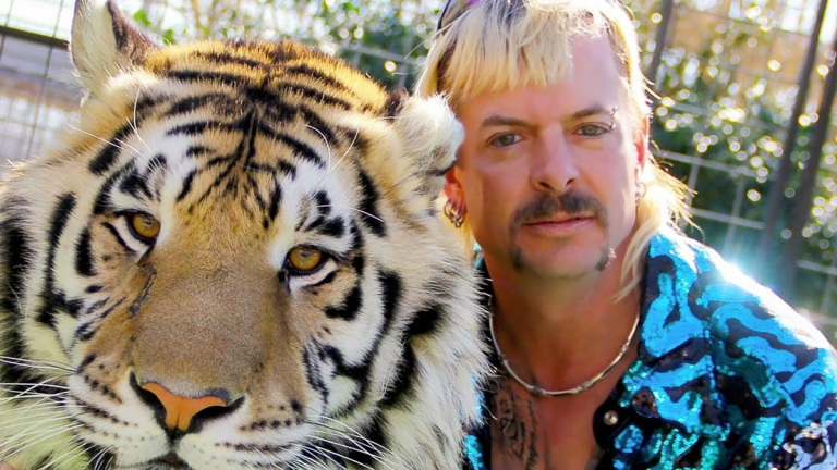 Joe Exotic and a tiger in Tiger King: Murder, Mayhem and Madness