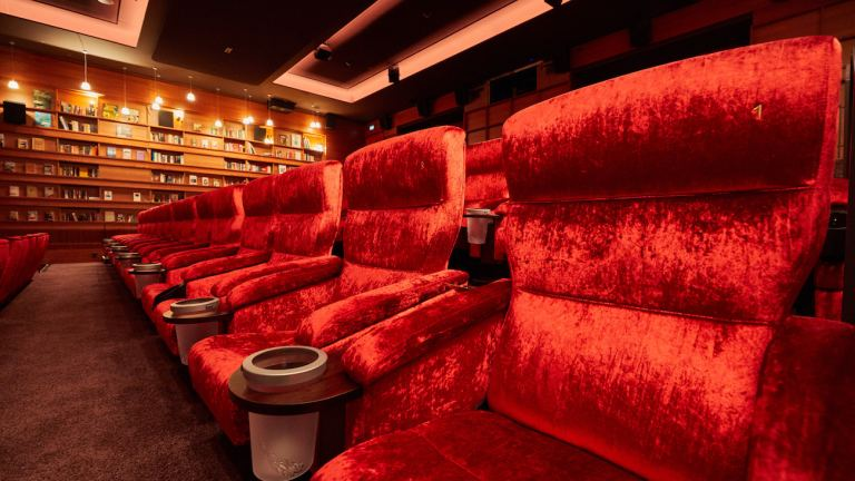 Empty luxury movie theater chairs