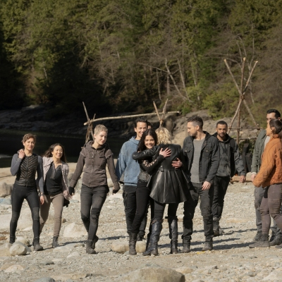 The Cast of The 100 Hugs on a Beach in The Series Finale