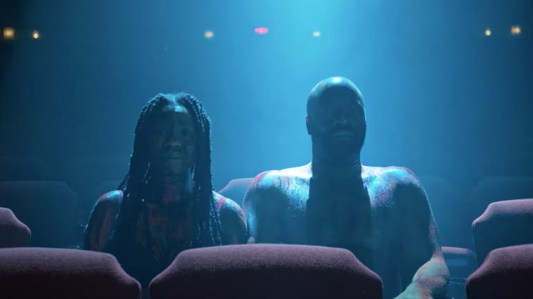 Couple sitting in dark movie theater - Monsterland