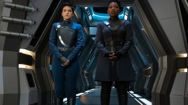 Blu del Barrio as Adira and Phumzile Sitole as Captain Ndoye Stand in a Starship Hall in Star Trek: Discovery Season 3 Episode 3