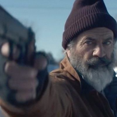 Mel Gibson as Santa Claus with a Gun