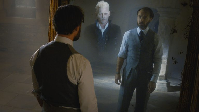 Jude Law as Dumbledore Looks Into the Mirror of Erised in Fantastic Beasts: The Crimes of Grindelwald