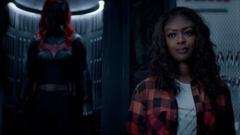 Jacivia Leslie as Ryan stands in front of the Batsuit in Batwoman Season 2