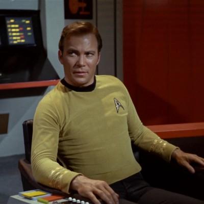 William Shatner as Captain Kirk sits on the bridge of the Enterprise