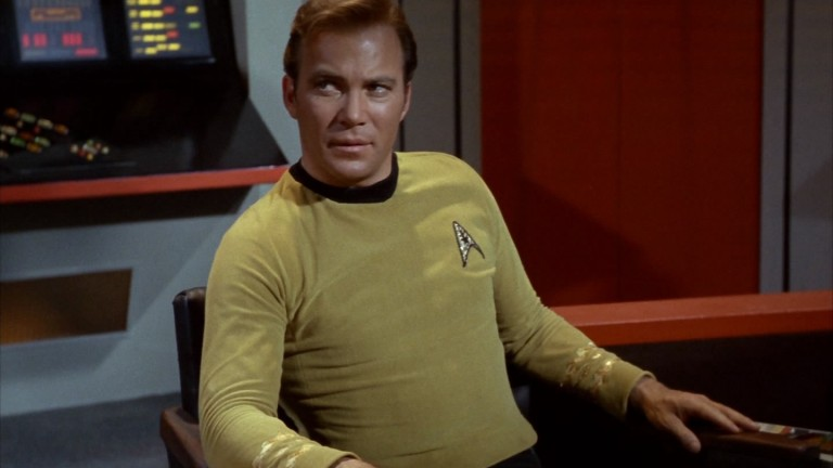 William Shatner as Captain Kirk sits on the bridge of the Enterprise