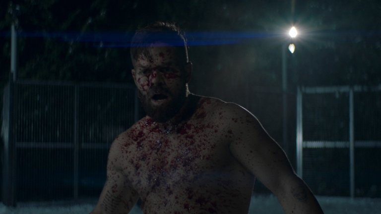 Amos covered in blood in The Expanse