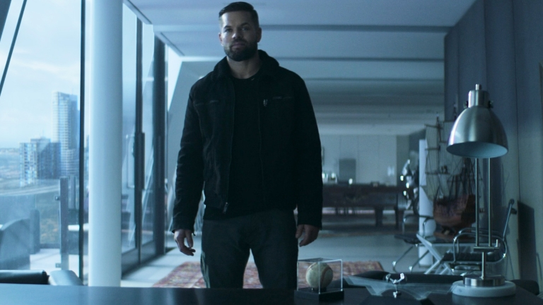 Amos stands in a Baltimore apartment in The Expanse Season 5