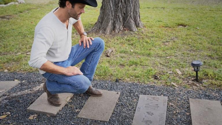 Jared Padalecki as Cordell Walker kneels by a gravestone