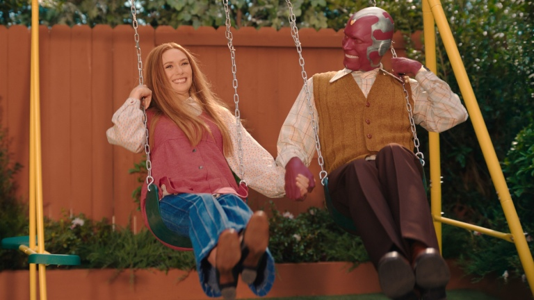 Wanda and Vision on a swingset