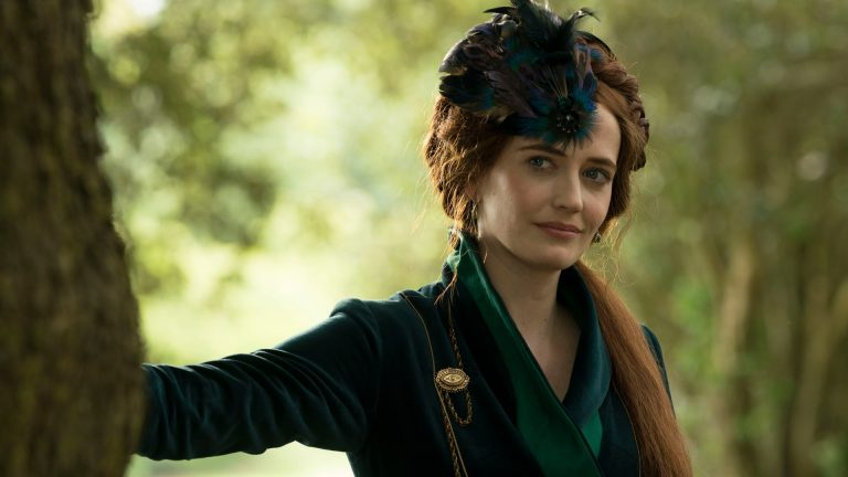 Eva Green wears a hat and leans against a tree in The Luminaries