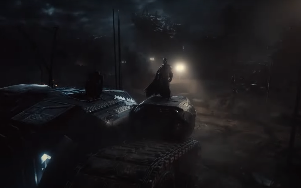 Batman stands on a tank vehicle in Zack Snyder's Justice League