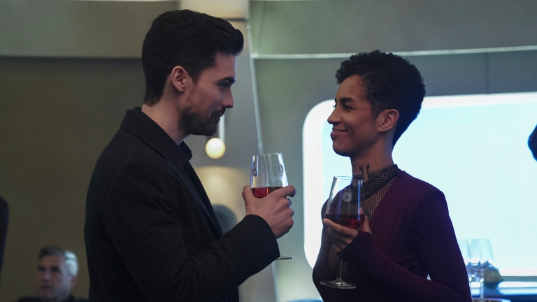 Holden and Naomi make a toast in The Expanse