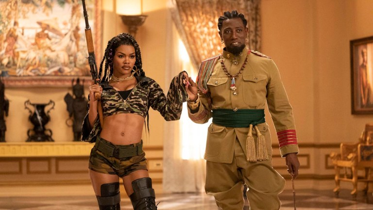 Wesley Snipes and Teyana Taylor holding weapons in Coming 2 America