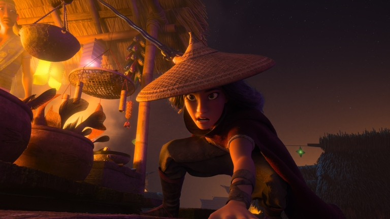 Southeast Asian Disney Princess Raya crouches in preparation for a fight in front of a lantern-lit market stall at night