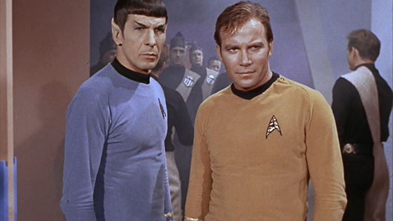 "Spock and Kirk stand together in Star Trek's ""A Taste of Armageddon"""
