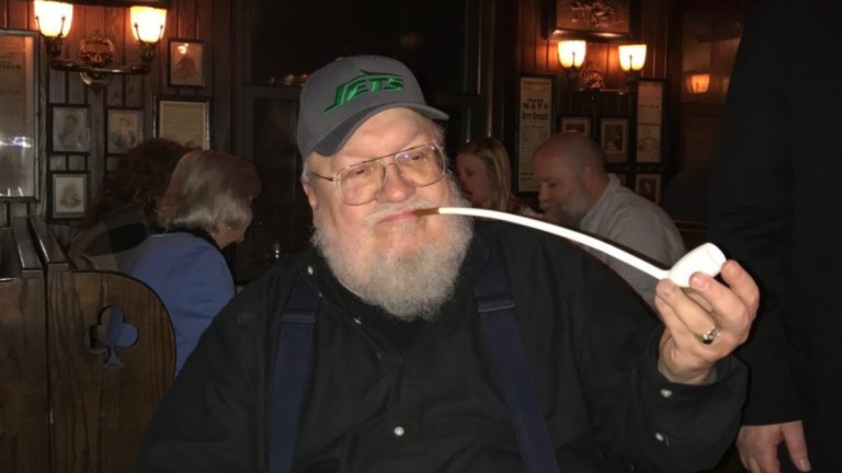 George R.R. Martin in a Jets hat