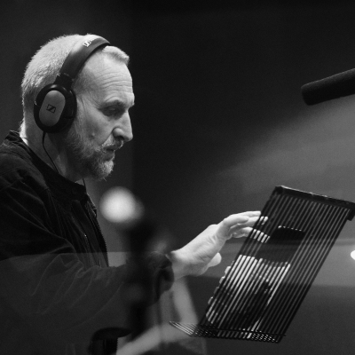 Christopher Eccleston in a sound studio recording Doctor Who stories for Big Finish