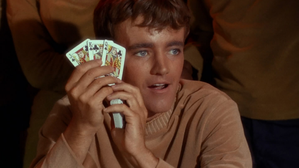 Charlie Evans holds up some cards in Star Trek: The Original Series