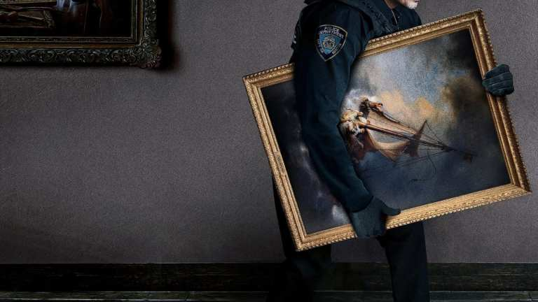 A man wearing a Boston Police uniform walks out of a museum with a Rembrandt under his arm