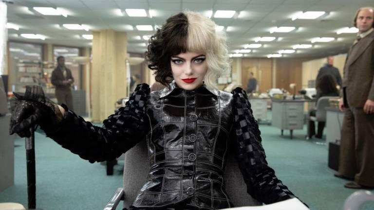 Emma Stone as Cruella with cane