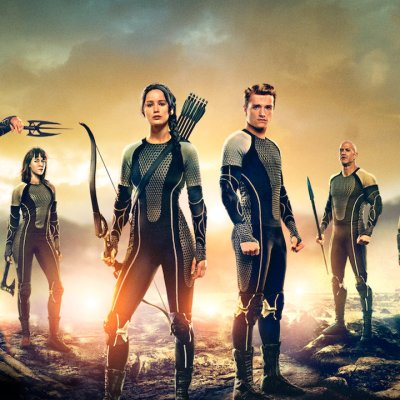 The tributes stand in a line in promo art for Hunger Games: Catching Fire