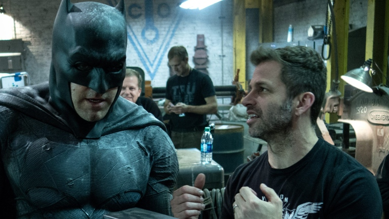 Ben Affleck as Batman, joined by Zack Snyder on the Justice League set.