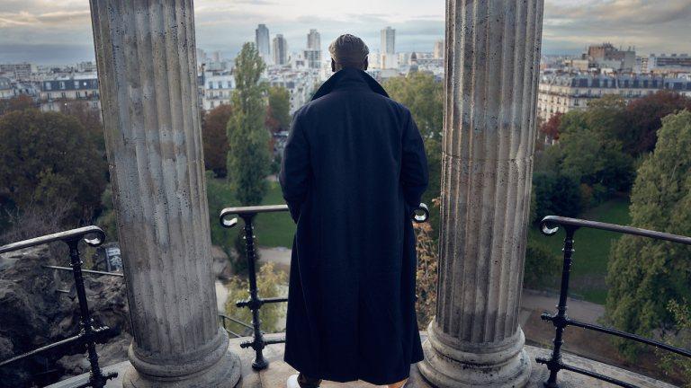 Assane stands overlooking Paris in Lupin Season 2