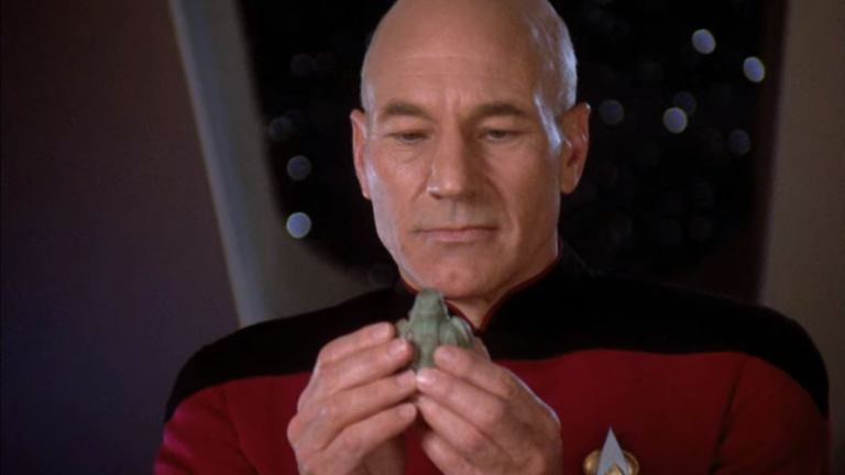 Captain Picard examines an artifact in Star Trek: The Next Generation