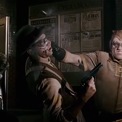 Nite Owl saving Thomas and Martha Wayne in Watchmen.