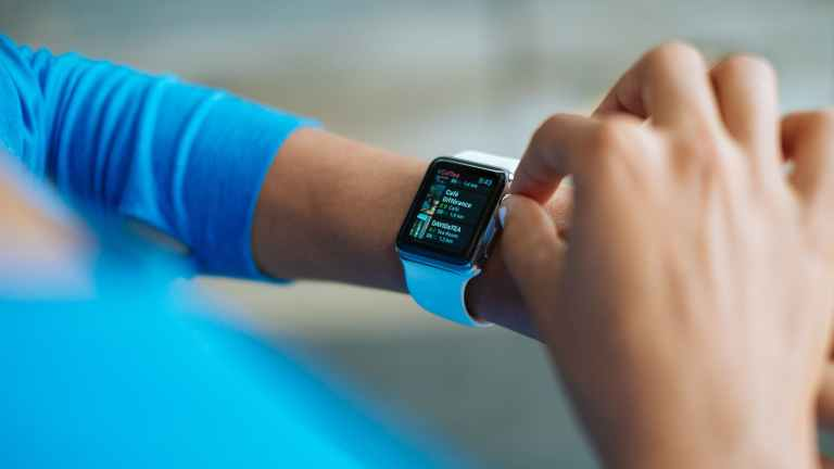 Wearable Technology; Adjusting Smart Watch on Left Wrist