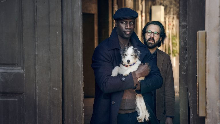 Assane Diop with a dog in Lupin season 2
