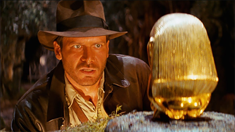 Indiana Jones and gold statue in Raiders of the Lost Ark