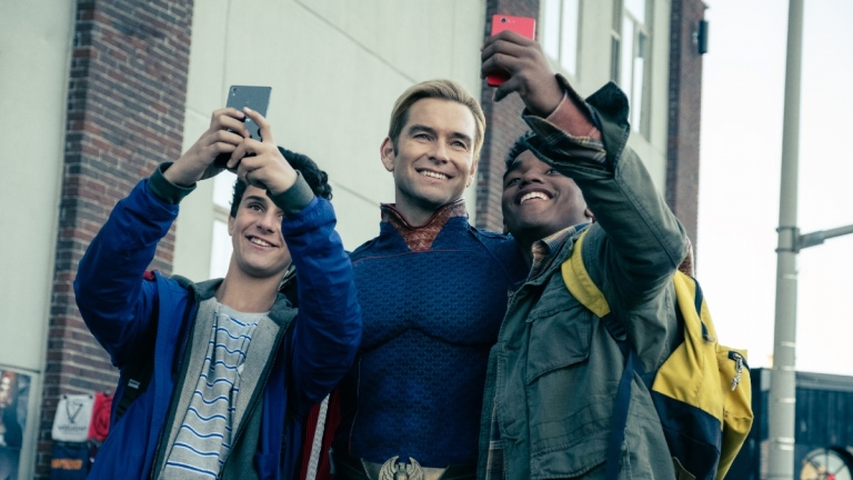 Homelander (Antony Starr) with some fans in The Boys season 1