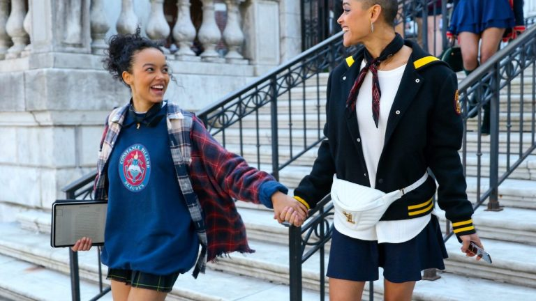 Two characters holding hands in the new Gossip Girl TV show