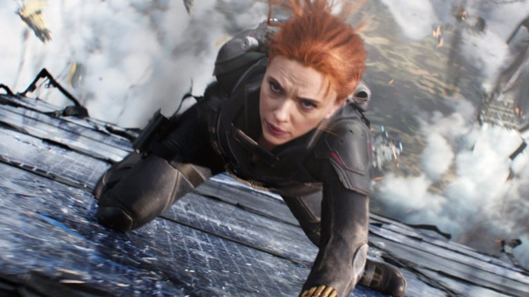 Natasha Romanov as the Black Widow slides down the side of a falling structure