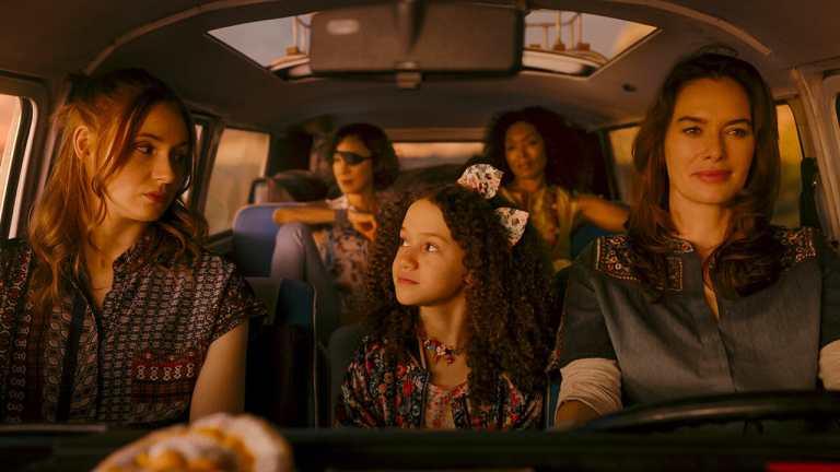 The cast of Gunpowder Milkshake in a car