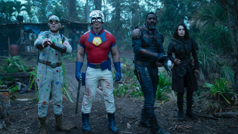 """DAVID DASTMALCHIAN as Polka Dot Man, JOHN CENA as Peacemaker, IDRIS ELBA as Bloodsport and DANIELA MELCHIOR as Ratcatcher 2 in Warner Bros. Pictures' action adventure """"THE SUICIDE SQUAD,"""" a Warner Bros. Pictures release."""