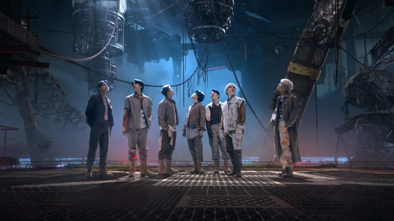 """The seven members of BTS against a futuristic planetscape in the """"My Universe"""" music video"""
