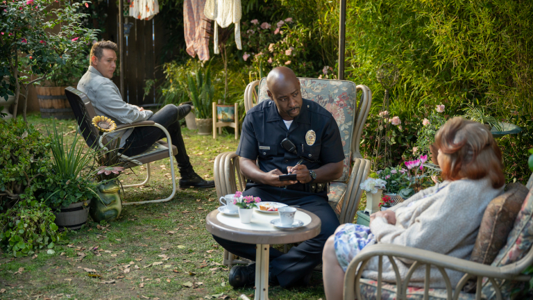 Kevin Alejandro as Daniel Espinoza looks on as officer Amenadiel questions a witness.